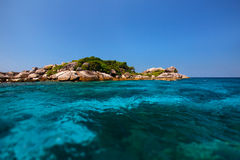 A small beautiful tropical island with clear turquoise water Royalty Free Stock Images
