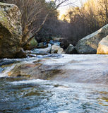 Small beautiful waterfall and rocks. A small and beautiful waterfall in a small and clean river in Spain Royalty Free Stock Image