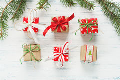 Small beautifully wrapped gifts on  white wooden background Royalty Free Stock Images