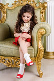 Small beauty in a chair Stock Photos