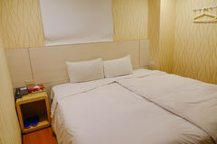 Small bed room at the cheap hotel Stock Image