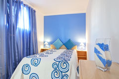 A small bedroom in blue. Royalty Free Stock Photo