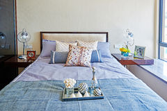 Small bedroom. Small modern, warm, inviting bedroom or hotel room Royalty Free Stock Photography