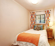 Small bedroom with nice bedding and hardwood floor. Stock Photos