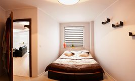 Small bedroom panorama Stock Image