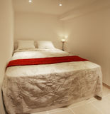 Small bedroom of white walls Royalty Free Stock Photography