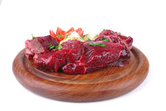 Small beef chunks on wooden plate Royalty Free Stock Photo