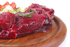 Small beef chunks on wooden plate Royalty Free Stock Image