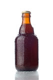 Small Beer bottle. With water drops isolated on white stock photography