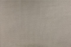 Small beige circles on gray background pattern stock image