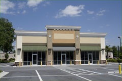 Small beige strip mall Stock Photos