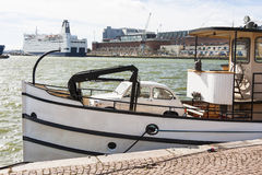 Small beige vehicle in a boat Royalty Free Stock Photo