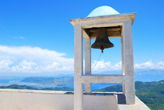 Small belfry with an old bell high above sea and land Stock Photos