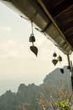 Small bell hanging under roof in temple Royalty Free Stock Images