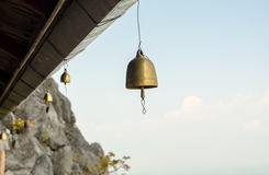 Small bell hanging under roof in temple Stock Photo
