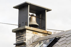 Small bell tower with bell Stock Photo