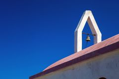 Small bell tower on the church in the mountains of Rhodes, Greece Stock Image