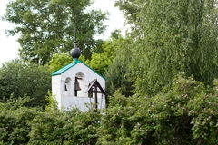 Small bell tower. Small white orthodox bell tower Royalty Free Stock Photo