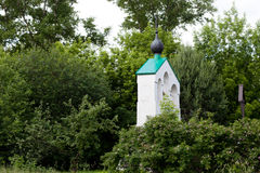 Small bell tower. Small white orthodox bell tower Royalty Free Stock Image