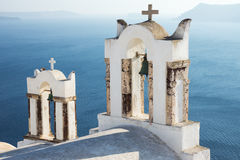 Small belltowers in Oia. Two small belltowers seen in Oia, Santorini stock photo