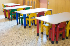 Small benches and small colored chairs in preschool Royalty Free Stock Photography