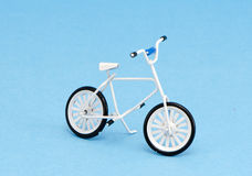 Small bicycle toy on azure background Stock Image