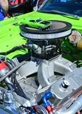 Small and Big. Lime green mini copy of an antique car placed on top of the engine, during the Maspeth 2012 Annual Antique Car Show Stock Photos
