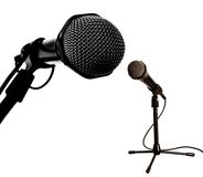 Small and big artists. Small and big microphones in like debate scene stock images