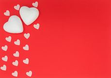 Small and big hearts on red  background. Small and big hearts on red background for valentines day, suitable for greeting card, restaurant menu template Royalty Free Stock Photo