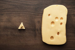 Small and big pieces of cheese Stock Photos