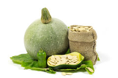 Small and Big Pumpkins and Pumpkin Seeds in Jute Bag on Green Leaf Isolated on White Royalty Free Stock Photos