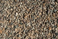 Small and big sand, gravel and pebbles background pattern Royalty Free Stock Photo