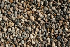 Small and big sand, gravel and pebbles background pattern Stock Photos