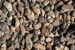Small and big sand, gravel and pebbles background pattern Royalty Free Stock Images