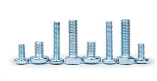 Small and big stainless steel screws isolated Stock Images