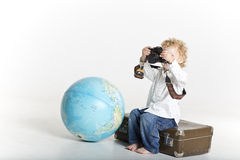 Small big traveling photographer Stock Photo