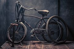 Small bike fix service with tools, wheels and tube. On dark background Royalty Free Stock Image