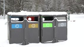 Small bins for rubbish and trash, recycling in winter park. Zoom out. 4K. Small bins for rubbish and trash, recycling in winter park. Containers for glass paper stock video