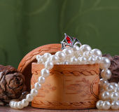 Small birch bark casket with pearl beads Stock Photo