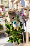 Small bird house handmade bird figure spring fair Royalty Free Stock Photo