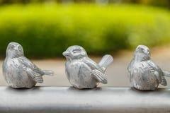 Small Bird Sculptures on a Handrail at Osaka Castle Park Stock Photos