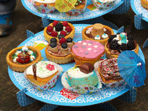 Small birthday cakes. Small birthday tarts garnished with fruits Royalty Free Stock Photography