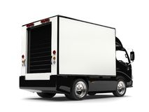 Small black box truck - back view. Isolated on white background Royalty Free Stock Images