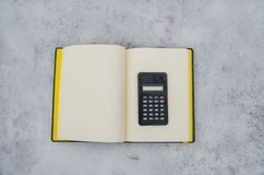 Calculator and notebook in the snow royalty free stock photo