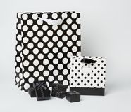 Small, black gift-boxes with black and white gift-bags with polka dots. Royalty Free Stock Image