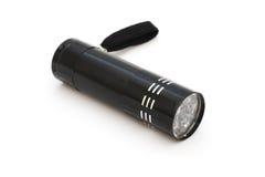 Small black LED flashlight Stock Images