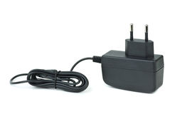 Small black power supply adapter Stock Images