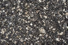 Small black road stones background. on the road royalty free stock photo