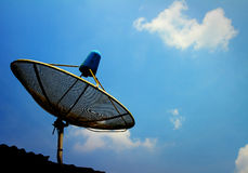 A small black satellite dish on roof Royalty Free Stock Photo