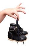 Small black shoes in children's hand Royalty Free Stock Photos